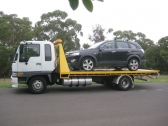 Tilt Tray Towing Adelaide- What is it all about?